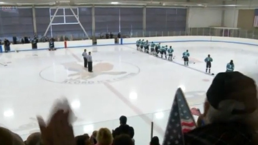Members of the community packed Acord Ice Arena to show support for a slain police officer's son.