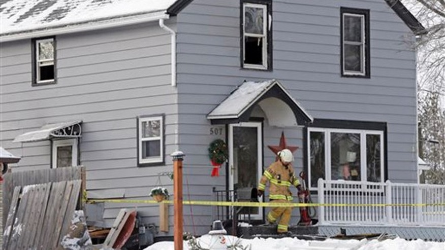 Sheboygan Falls assistant fire chief Wade Ubbelohde leaves a home on the 500 block of Western Ave. in Sheboygan Falls, Wis., Wednesday, Jan. 27, 2016, the day after a fatal fire.