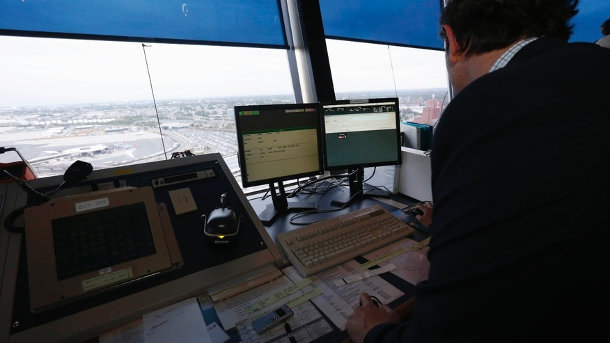 FILE - In this May 21, 2015 file photo, the Newark Liberty International Airport the air traffic control tower in Newark, N.J.