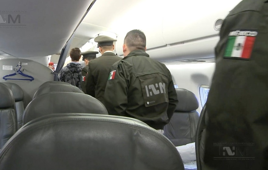 "This frame grab taken from a Thursday, Jan. 28, 2016 video provided by Mexico's Instituto Nacional de Migracion, INM, shows Ethan Couch, escorted onto a plane by Mexican immigration agents, in Mexico City. INM says it has taken the Texas teenager who used an ""affluenza"" defense in a fatal drunken-driving accident to the Mexico City airport, to fly him back to Texas to face charges. Couch was placed on a commercial flight to Dallas, Texas. (Instituto Nacional de Migración, INM via AP)"