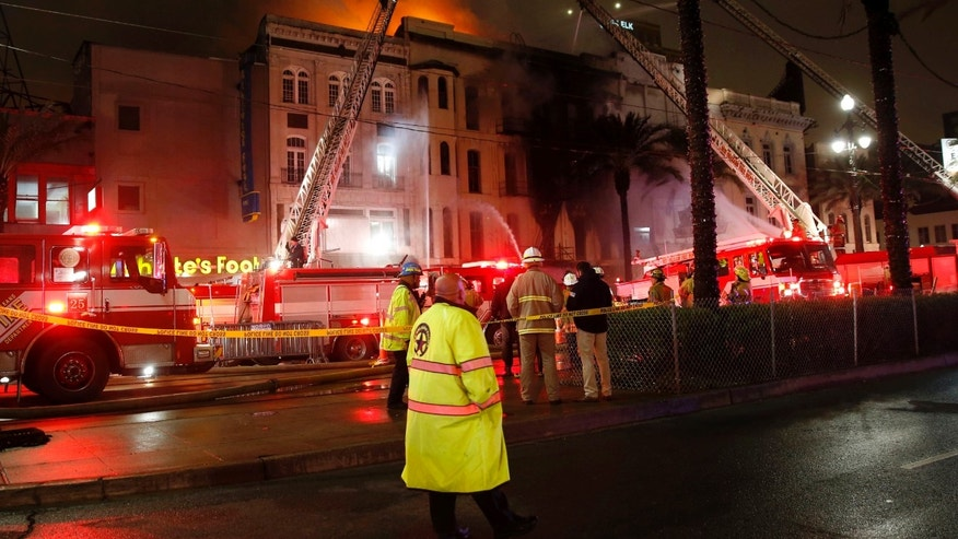 Jan. 27, 2016: Firefighters battle a fire on Canal Street in downtown New Orleans.