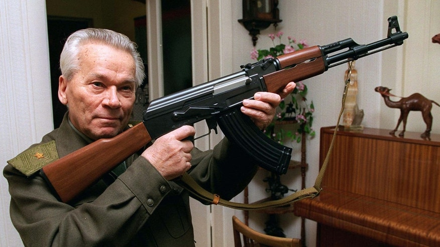 Mikhail Kalashnikov, shown here with his namesake rifle, invented the AK-47 after he was wounded in World War II.