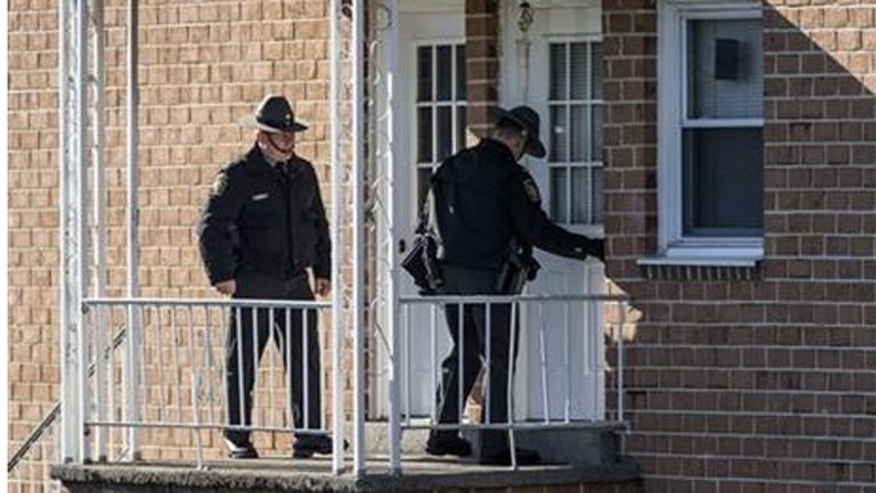 In this Jan. 11, 2016 photo, State police investigate the scene where Ciara Meyer, 12, was killed after a confrontation between her father and a constable. (Dan Gleiter/PennLive.com via AP)