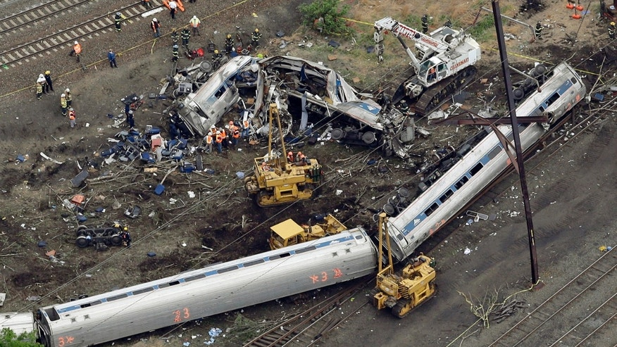 In this May 13, 2015 file photo, emergency personnel work at the scene of a derailment in Philadelphia of an Amtrak train headed to New York. (AP Photo/File)