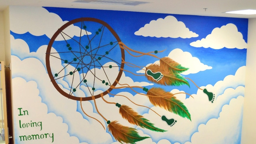 A mural created by Lindsay Fuori to pay tribute to Sandy Hook Elementary School shooting victims has been covered with plasterboard.
