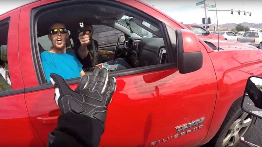 A driver pulled a gun on a motorcyclist in Nevada during an argument caught on video.