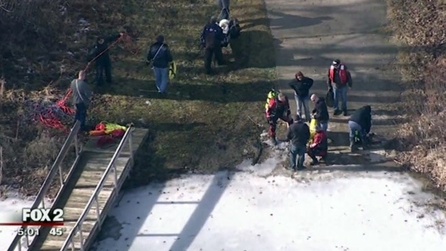 Authorities conduct a search for a father and son on Alderman Lake in Highland, Mich.