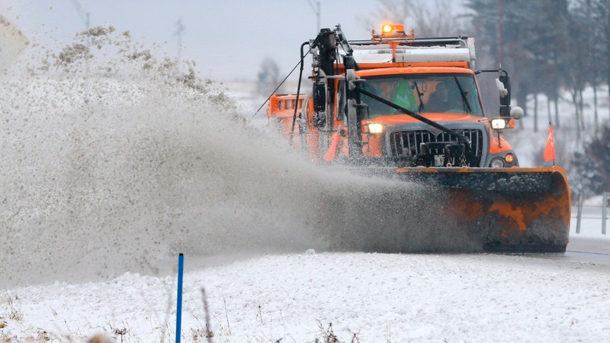 A snowplow clears snow off of Interstate 80 near  Earlham, Iowa, Tuesday, Feb. 2, 2016. A winter storm that dumped heavy snow on Denver and much of Colorado has moved east into Nebraska and Iowa. (AP Photo/Nati Harnik)