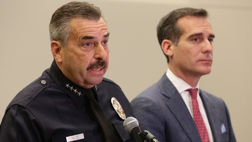 FEb. 4, 2016: Los Angeles Police Chief Charlie Beck, left, and Los Angeles Mayor Eric Garcetti take questions about the bodies found at a park, during a news conference at LAPD headquarters in Los Angeles.