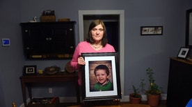 ADVANCE FOR USE SATURDAY, FEB. 6, 2016 AT 8 A.M. EST AND THEREAFTER; THIS STORY MAY NOT BE PUBLISHED, BROADCAST OR POSTED ONLINE BEFORE SATURDAY, FEB. 6, 2016 AT 8 A.M. EST - Hollie Ayers poses with a photograph of her late son, Michael, 2, at her home in Bedford, Pa., on Monday, Jan. 18, 2016. Michael, was shot and killed in front of her by her abusive ex-husband in 2013. Ayers was shot in the face and the leg, and her ex-husband killed himself after the rampage. More than a dozen states over the past two years have strengthened laws meant to keep firearms out of the hands of domestic abusers, a rare area of consensus in the nation's highly polarized debate over guns. (AP Photo/ John Beale)