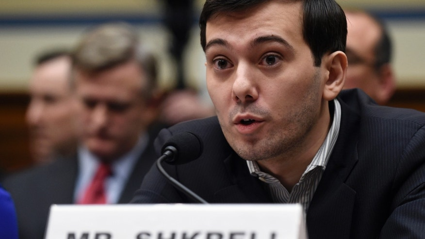 Pharmaceutical chief Martin Shkreli speaks on Capitol Hill in Washington, Thursday, Feb. 4, 2016, during the House Committee on Oversight and Reform Committee hearing on his former company's decision to raise the price of a lifesaving medicine. Shkreli refused to testify before U.S. lawmakers who excoriated him over severe hikes for a drug sold by a company that he acquired. (AP Photo/Susan Walsh)