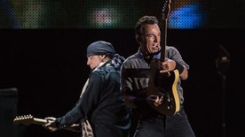 American Bruce Springsteen (R) performs during the Rock in Rio music festival in Rio de Janeiro, Brazil, on September 22, 2013.