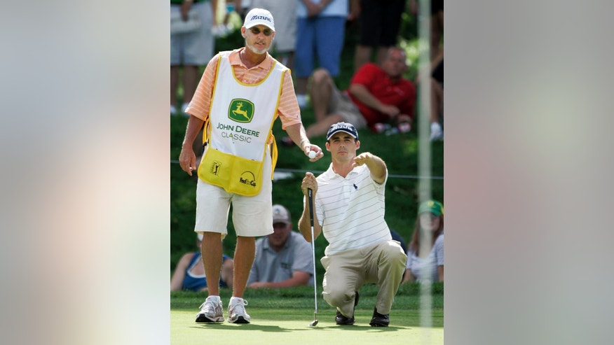 A group of PGA Tour caddies has filed a class-action lawsuit Tuesday, Feb. 3, 2015, in northern California, demanding that the tour compensate them for wearing bibs.
