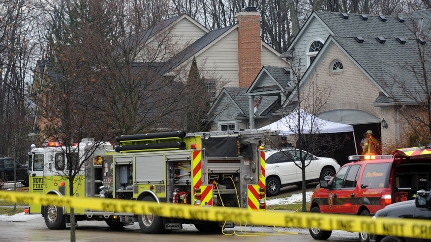 Jan. 31, 2016: Police and fire officials investigate a house fire that killed five people at a home in Novi, Mich..