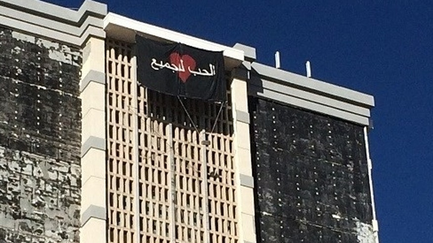 A banner with Arabic-style writing was seen hanging from a Texas building.