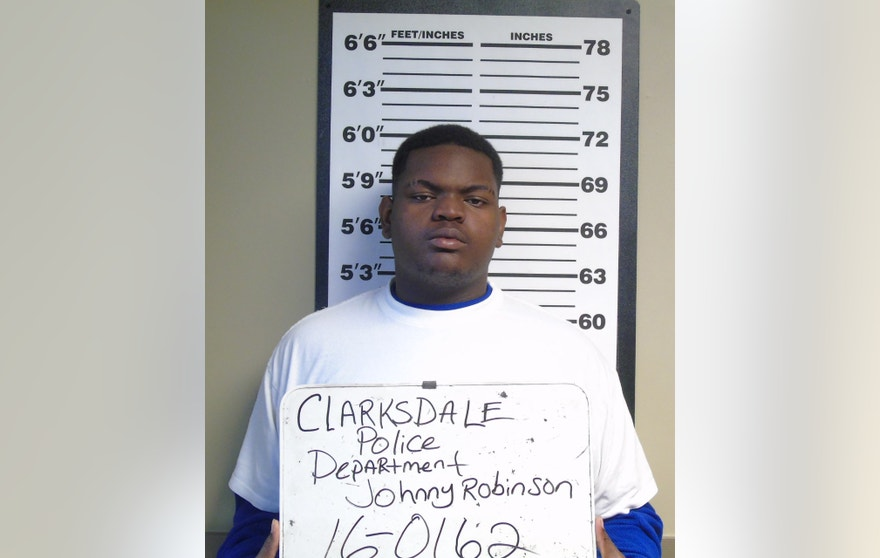 A Sunday, Feb. 14, 2016, booking photograph released by the Clarksdale, Miss., Police Department shows Johnny Robinson Jr., who was charged Monday, Feb. 15, with attempted murder and one count of armed robbery in the Saturday night shooting of police Cpl. Derrick Couch. (Clarksdale Police Department HO via AP)