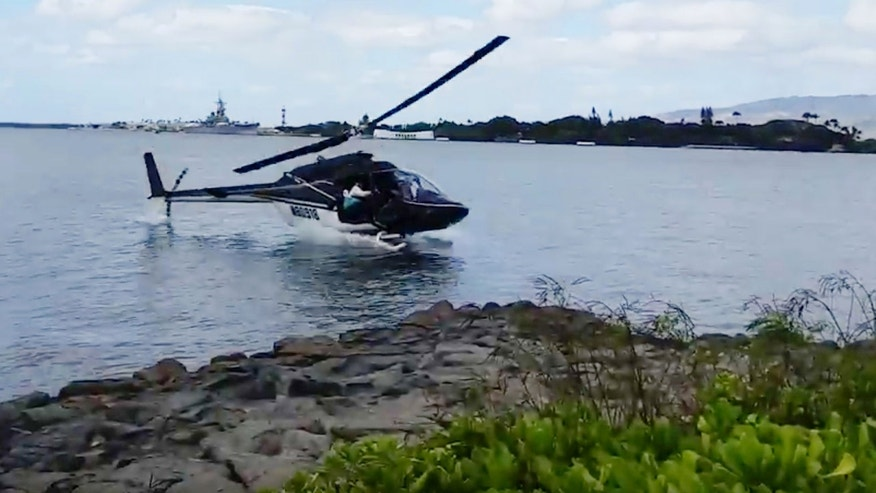 Feb. 18, 2016: In this image taken from video provided by Shawn Winrich, a helicopter crashes near Parl Harbor, Hawaii (Shawn Winrich via the AP)