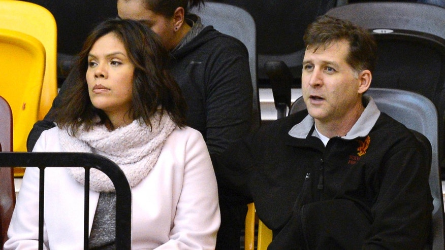 From left, Santa Fe Indian School's former head boys basketball coach Ceci Moses and her husband, Rick Schimmel, attend the school's boys basketball game Tuesday, Feb. 23, 2016 in the Pueblo Pavilion at Santa Fe Indian School in Santa Fe, New Mexico.