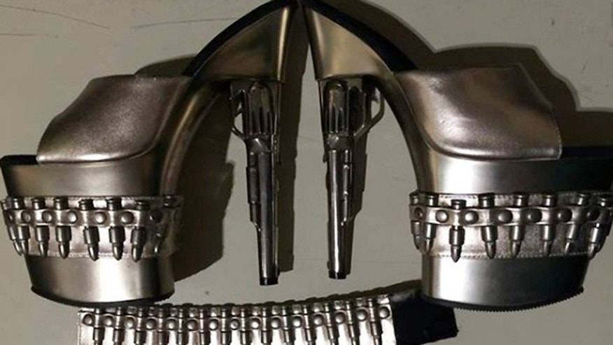 A pair of gun-shaped stiletto heels worn by a woman at Baltimore-Washington International Thurgood Marshall Airport.
