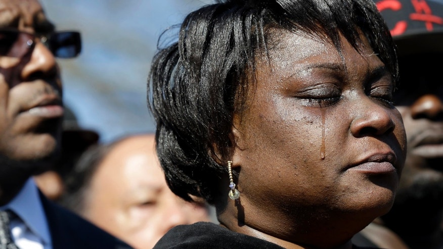 Rolonda Byrd, the mother of shooting victim Akiel Denkins, cries during a news conference.