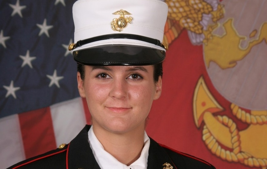 This undated photo provided by the U.S. Marine Corps shows Ashley Guindon, a Prince William County, Va. Police Department officer  killed last Saturday night in the quadruple shooting in Woodbridge, Va.  (U.S. Marine Corps via AP)