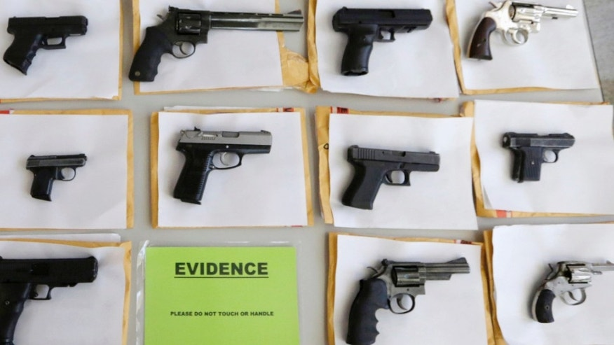 In this July 7, 2014 file photo, Chicago police display some of the thousands of illegal firearms they confiscated during the year in their battle against gun violence in Chicago. At a news conference Tuesday, March 1, 2016, Chicago police said there have been about twice as many homicides and shootings so far this year in Chicago as compared to the same period in 2015.