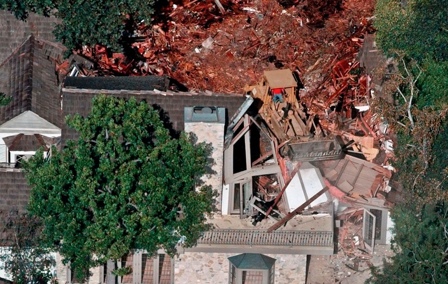 FILE: Crews demolish the former home of O.J. Simpson, Wednesday, July 29, 1998, in the Brentwood area of Los Angeles. Detectives are investigating a knife purportedly found some time ago at the former home of O.J. Simpson, who was acquitted of murder charges in the 1994 stabbings of his ex-wife Nicole Brown Simpson and her friend Ron Goldman, Neiman said Friday. (AP Photo/Mark J. Terrill)