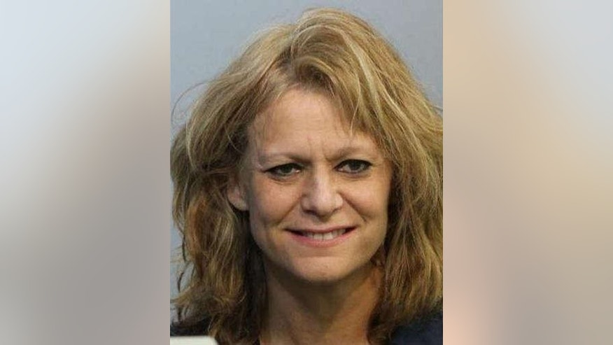 Photo shows Holly Joel, 52, who was arrested after allegedly showing up to teach her class drunk.