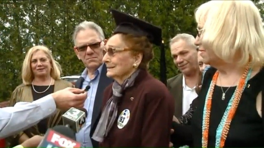 Dorothy Liggett, center, receiving her diploma.