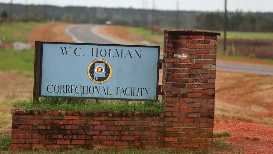 The sign to The William C. Holman Correctional Facility in Atmore, Ala., is displayed on Saturday March 12, 2016.