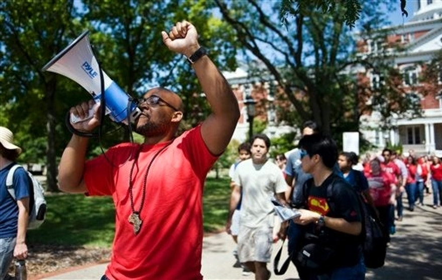 """In this Aug. 26, 2015 photo, Jonathan Butler uses a megaphone during a """"day of action"""" demonstration to draw attention to graduate students' demands in front of Jesse Hall on the University of Missouri campus in Columbia, Mo. Butler began his hunger strike on Nov. 2 to call attention to racial problems at the state's flagship university. (Daniel Brenner/Columbia Daily Tribune via AP) MANDATORY CREDIT"""