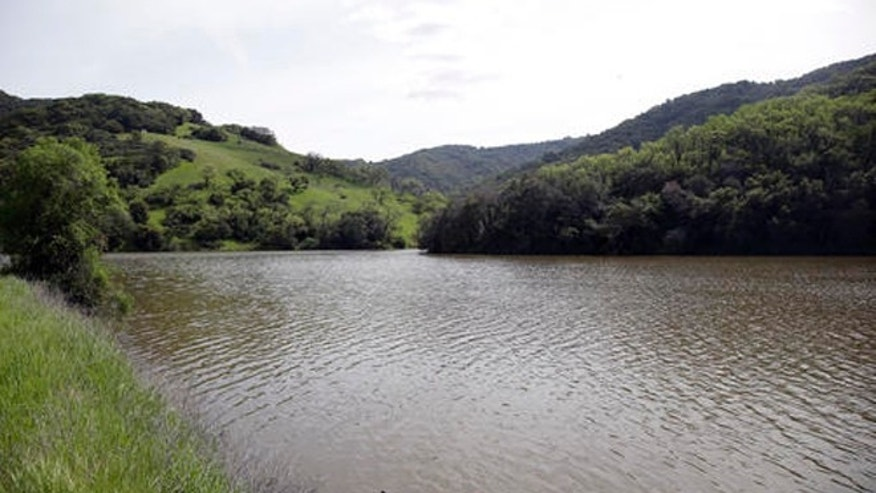 The Almaden Reservoir is filled after series of storms Monday, March 14, 2016, in San Jose, Calif. Four straight days of rain have replenished several key reservoirs in drought-stricken California. (AP Photo/Marcio Jose Sanchez)