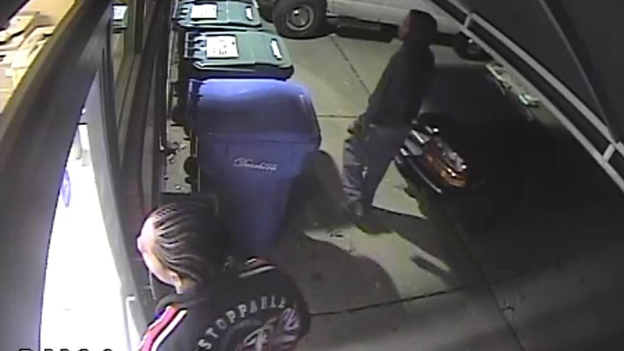 This photo from video surveillance shows two men trying to break into the Detroit-area offices of The Arab American News.
