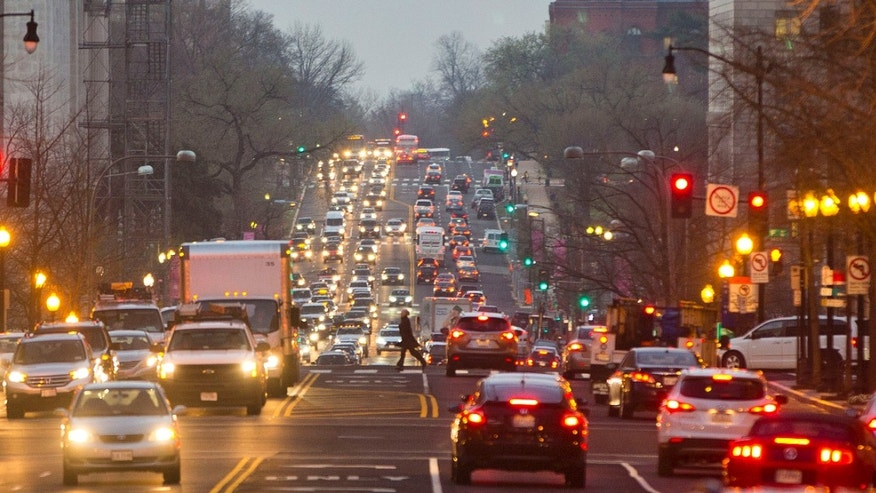 Traffic building up on 14th Street NW in downtown Washington on Wednesday.