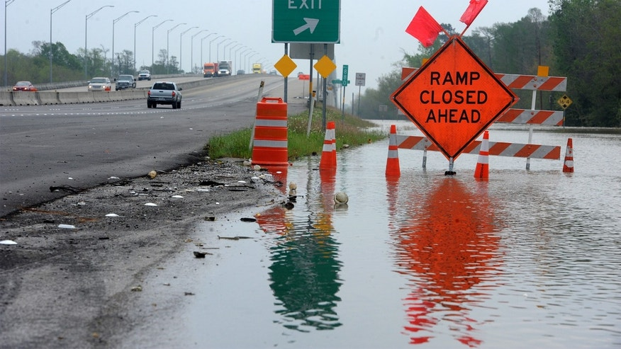 Floodwaters build up along Interstate 10 near Orange, Texas.