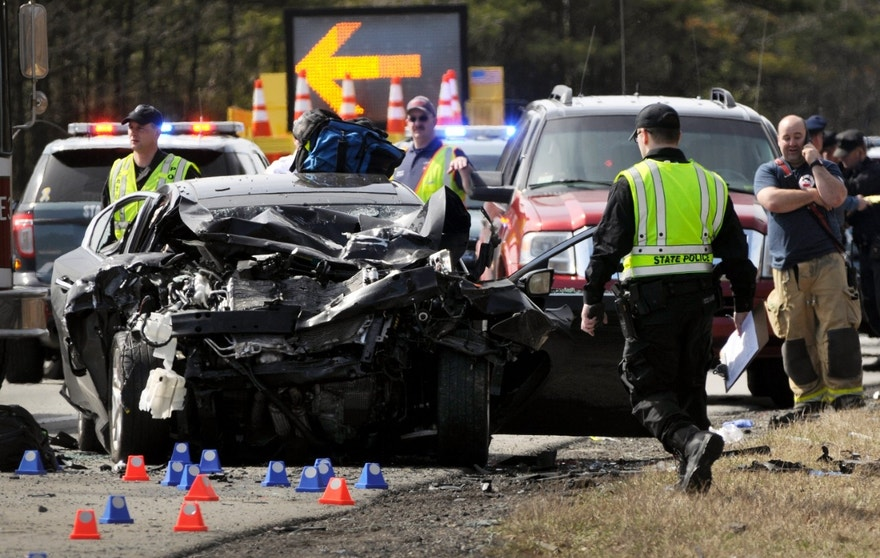 Massachusetts State Police investigate a car involved in a serious accident east of exit 9 on the Massachusetts Turnpike on Wednesday, March 16, 2016. Massachusetts State Police trooper, Thomas Clardy, who was injured in the crash on the Massachusetts Turnpike has died, according to authorities. (Paul Kapteyn/Worcester Telegram & Gazette via AP) MANDATORY CREDIT