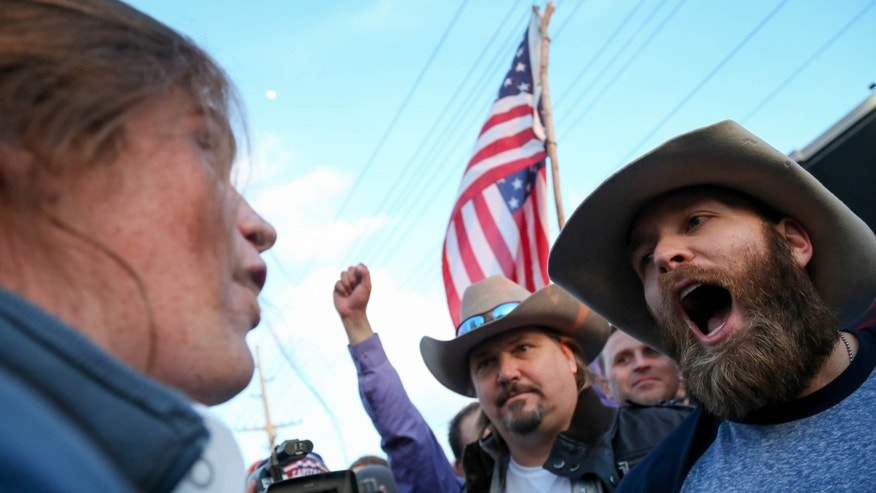 March 18, 2016: A protester confronts supporters of Republican presidential candidate Donald Trump in downtown Salt Lake City as Donald Trump gave his first campaign speech in Utah.