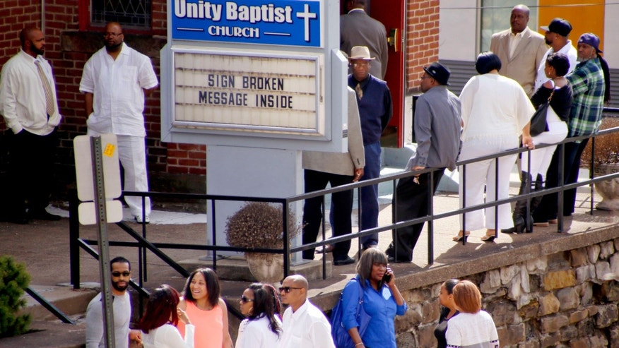 March 14, 2016: People gather on the landing outside the Unity Baptist Church in Braddock, Pa. for viewing of Shada Mahone before her funeral.