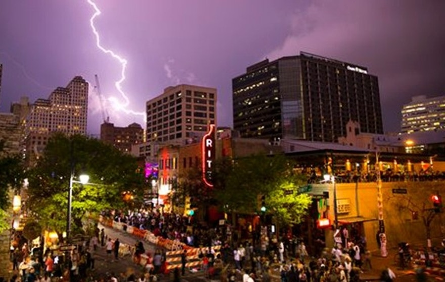 Lightning streaks across the sky over 6th Street during  South by Southwest festival on Friday, March 18, 2016, in Austin, Texas. (Jay Janner/Austin American-Statesman via AP) MANDATORY CREDIT; AUSTIN CHRONICLE OUT; COMMUNITY IMPACT OUT; INTERNET AND TV MUST CREDIT PHOTOGRAPHER AND STATESMAN.COM; MAGS OUT