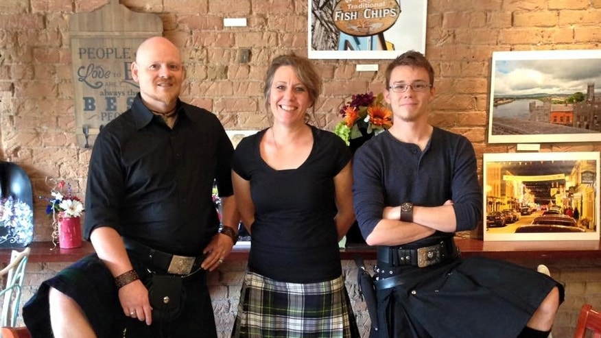 Tony Siebers, left, Monika Siebers and son Collin Siebers wear kilts and carry guns at Sea Bears Ogden Fish House in Utah.