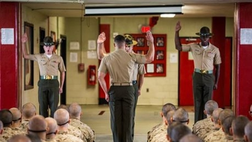 Marine recruits and drill instructors at the Parris Island training depot.