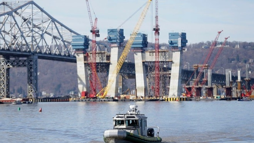 A New York State Police boat passes near the site of a fatal collision in the water underneath the Tappan Zee Bridge in Tarrytown, N.Y.