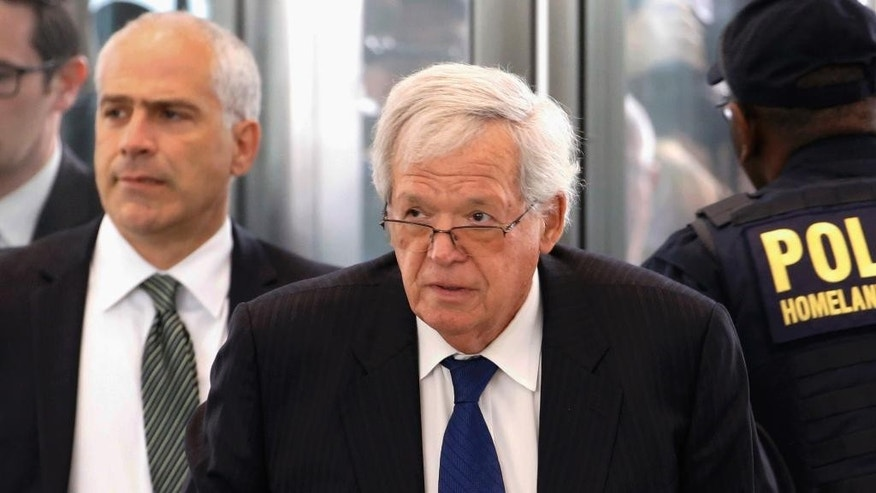 "FILE - In this June 9, 2015 file photo, former U.S. House Speaker Dennis Hastert arrives at the federal courthouse in Chicago for his arraignment on federal charges in his hush-money case. A filing in Hastert's hush-money case confirms prosecutors intend to call at least one witness at the former U.S. House speaker's sentencing, though the order posted on Wednesday, March 23, 2016, by the presiding judge doesn't identify that witness. Hastert pleaded guilty to violating bank laws in seeking to pay $3.5 million in hush money to some referred to in the indictment only as ""Individual A."" Prosecutors have spoken before about giving victims closure but never identified any. (AP Photo/Charles Rex Arbogast, File)"