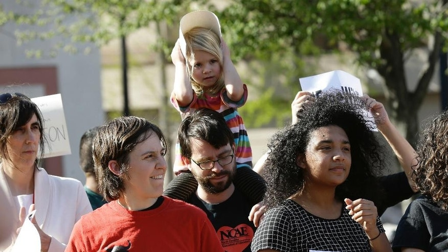 Supporters of 19-year-old Wildin Acosta hold a rally in Durham, N.C., Thursday, March 24, 2016. Supporters are calling on federal immigration officials to release Acosta and other detained teenagers who came to the U.S. as unaccompanied children. (AP Photo/Gerry Broome)