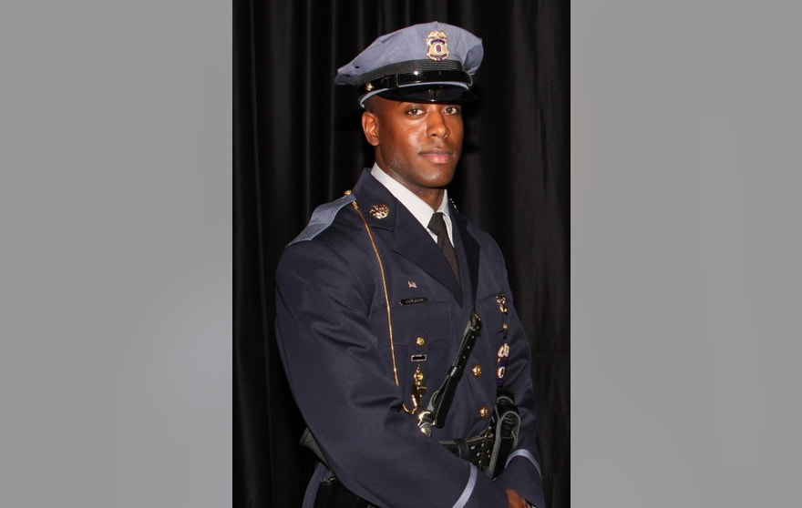 This undated photo provided by the Prince George's County Police Department shows officer Jacai Colson, a 4-year veteran of the Maryland county's police force. A gunman fired outside a Maryland police station on Sunday, March 13, 2016, prompting a gun battle that killed Colson and wounded the suspect, authorities said. (Prince George's County Police Department via AP)