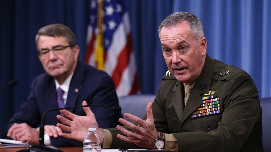 Joint Chiefs Chairman Gen. Joseph Dunford, with Defense Secretary Ash Carter, speaks during a news conference at the Pentagon, Friday, March 25, 2016, where they announced U.S. forces killed a senior Islamic State leader, among several key members of the militant group eliminated this week. (AP Photo/Mauel Balce Ceneta)