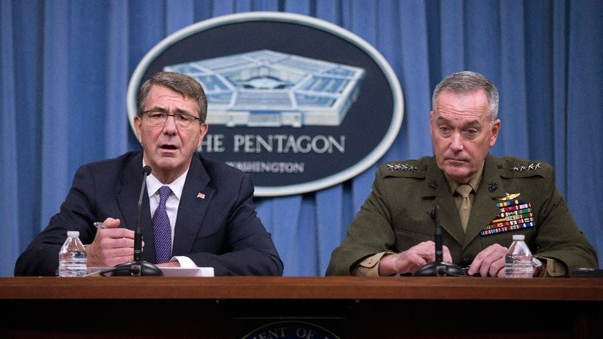 Defense Secretary Ash Carter, accompanied by Joint Chiefs Chairman Gen. Joseph Dunford, speaks during a news conference at the Pentagon, Friday, March 25, 2016, where they announced U.S. forces killed a senior Islamic State leader, among several key members of the militant group eliminated this week. (AP Photo/Mauel Balce Ceneta)