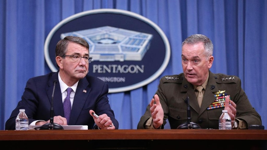 Defense Secretary Ash Carter listens at left as Joint Chiefs Chairman Gen. Joseph Dunford speaks during a news conference at the Pentagon, Friday, March 25, 2016, where they announced U.S. forces killed a senior Islamic State leader, among several key members of the militant group eliminated this week. (AP Photo/Mauel Balce Ceneta)