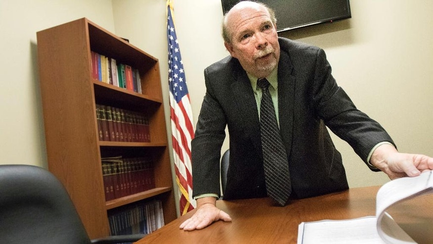 DeKalb County State's Attorney Richard Schmack looks through pages of documents included as exhibits to support his vacating the conviction response to Jack McCullough's post conviction filings in his conference room at the DeKalb County Courthouse in Sycamore, Ill., Friday, March 25, 2016. Jack D. McCullough was convicted of the 1957 murder of 7-year-old Maria Ridulph in September of 2012. McCullough will appear in court on Tuesday, March 29.  (Danielle Guerra/Daily Chronicle via AP) MANDATORY CREDIT; CHICAGO TRIBUNE OUT