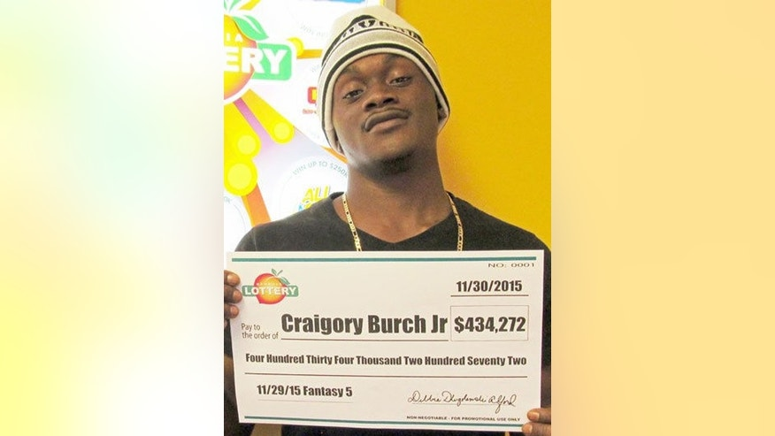 Nov. 30, 2016: This photo shows Craigory Burch Jr. with his winnings from the George Lottery's Fantasy 5 game. Burch was shot and killed in an attempted robbery on Jan. 20 of this year.